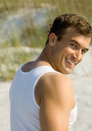 distractions: Man looking over shoulder, dune in background