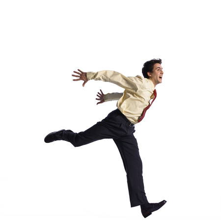 Man jumping with arms behind back LANG_EVOIMAGES