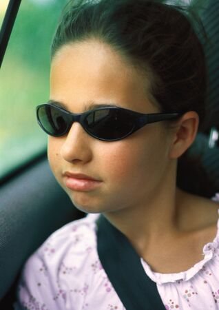 Girl in car wearing seat belt