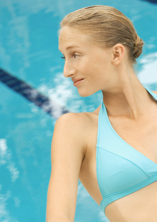distractions: Woman in bikini sitting by pool
