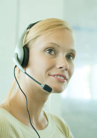 distractions: Woman wearing headset LANG_EVOIMAGES