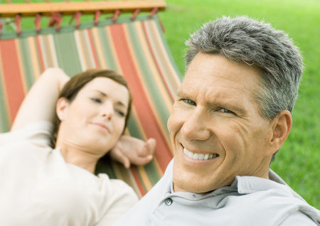 Mature couple lounging in hammock