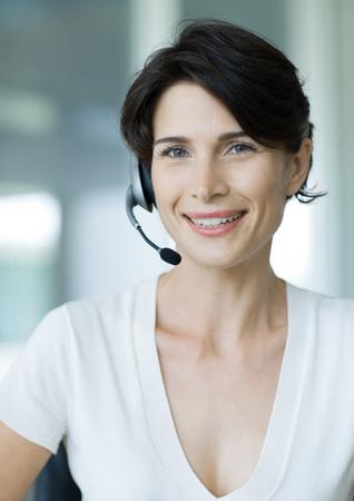 Woman wearing headset LANG_EVOIMAGES