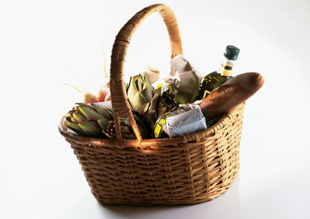 containing: Market basket containing bread, artichokes, and bottle LANG_EVOIMAGES