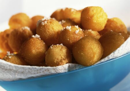 Bowl of dauphine potatoes sprinkled with sea salt, close-up LANG_EVOIMAGES