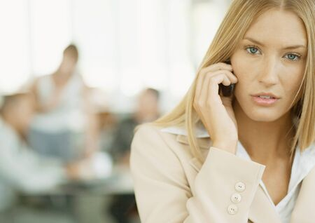 hear business call: Woman using cell phone LANG_EVOIMAGES