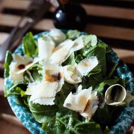 Arugula salad with parmesan shavings and balsamic vinaigrette
