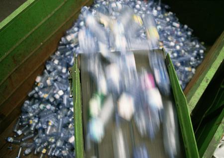 Plastic bottles being sorted into large bin