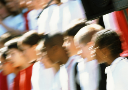 chorale: Group of people, head and shoulders, blurred