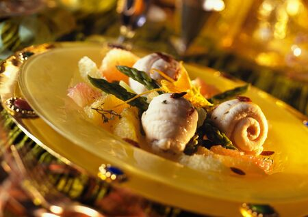 Sole with citrus fruits and asparagus on plate, close-up LANG_EVOIMAGES