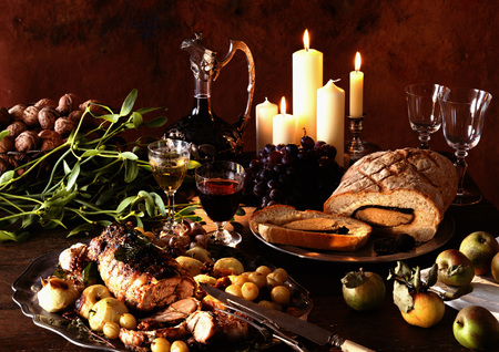 carnes y verduras: Dishes of meats, fruits and vegetables, with carafe of wine and candles in background