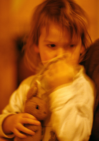 Girl hugging stuffed rabbit, portrait, blurred