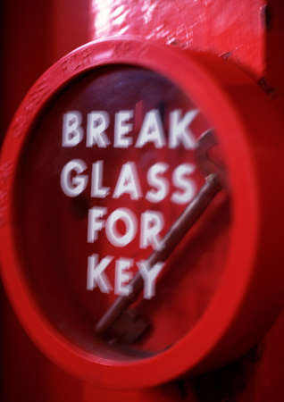 emergency exits: Key behind glass with break glass for key text LANG_EVOIMAGES