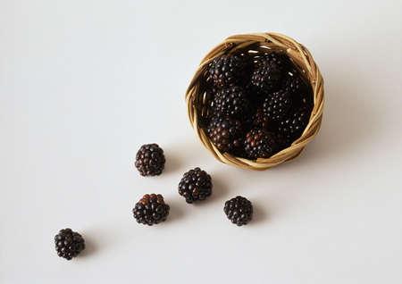 Blackberries spilling out of basket