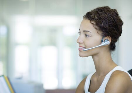 Woman wearing headset LANG_EVOIMAGES