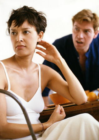 Couple arguing over breakfast, man yelling while woman looks away in anger