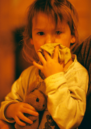 sucks: Girl hugging stuffed rabbit, portrait