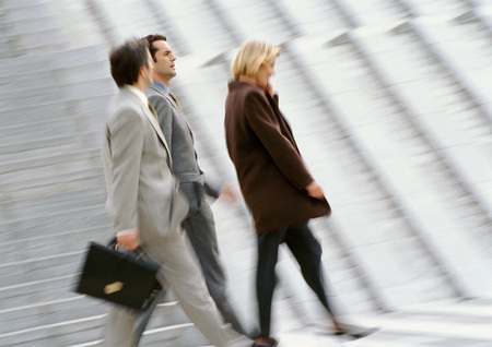Three business people walking, blurred LANG_EVOIMAGES