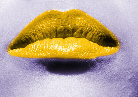 Close up of womans mouth with yellow lipstick