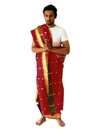 Hindu man standing and praying, full length