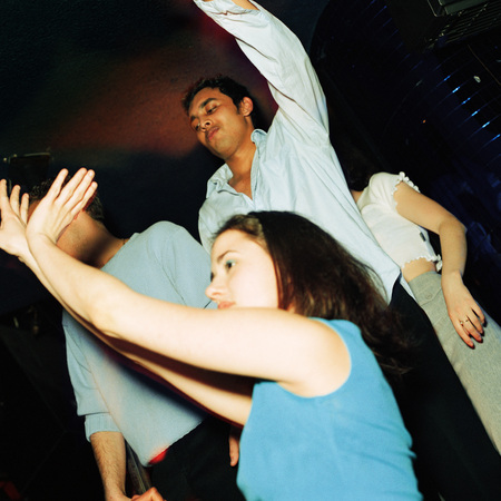 Group of young people dancing in nightclub