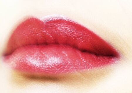 Womans mouth with lipstick, blurred, extreme close-up