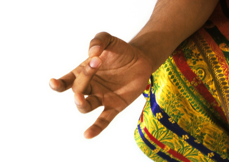 Close up of Hindu mans hand in meditation