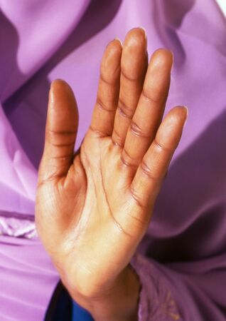Womans palm held up in prayer, close-up