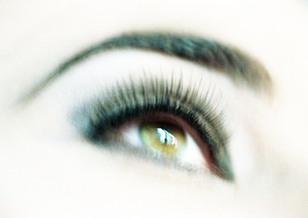 beauties: Womans made-up eye, close-up, blurry