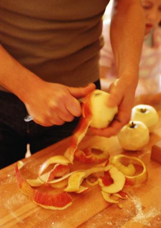deftness: Hands peeling apples LANG_EVOIMAGES