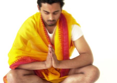 Hindu man praying, blurry