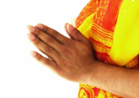 Close up of Hindu mans hands in prayer LANG_EVOIMAGES