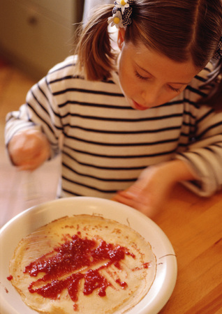 Child preparing crepe, blurred motion