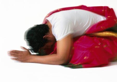 Hindu man bowing and praying, blurry
