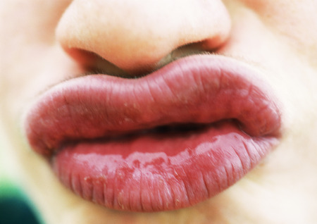 Close up of womans puckered lips