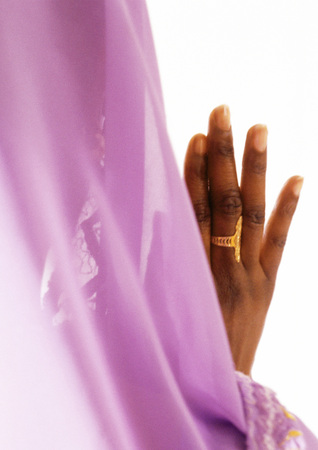 Veil and womans hand, close-up
