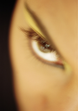Womans made-up eye, blurred close-up