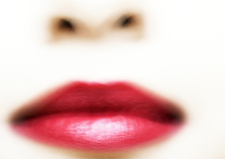 beauties: Womans mouth with red lipstick, blurred extreme close-up LANG_EVOIMAGES