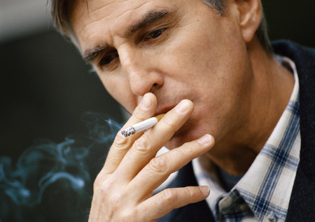 Man smoking cigarette, close up