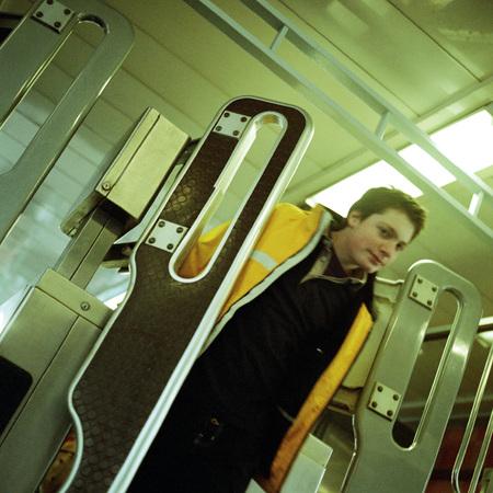Young man walking through turnstile gate in subway