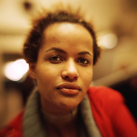 Teenage girl looking at camera, close-up, portrait