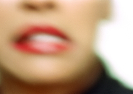 Close up of womans mouth, blurry