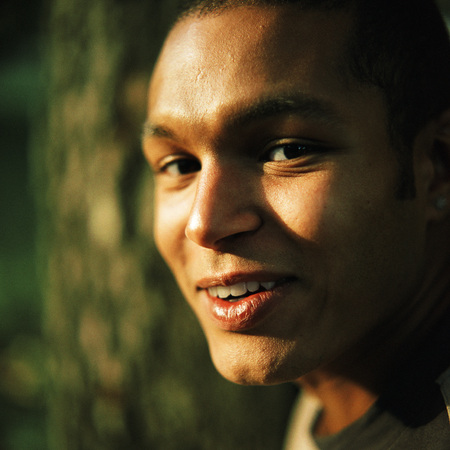 Young man smiling outside, close up, portrait