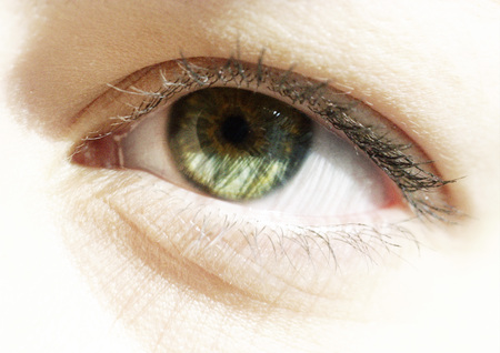 curiousness: Womans green eye, close up LANG_EVOIMAGES
