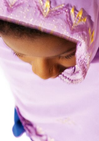 Muslim woman wearing veil, close-up, high angle view LANG_EVOIMAGES