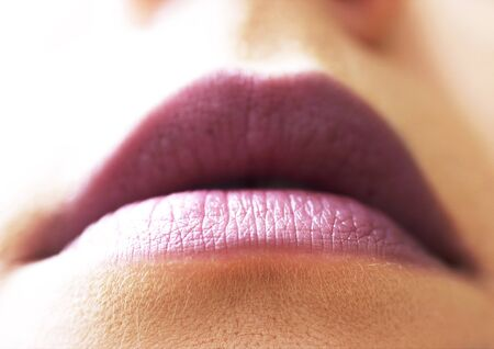 Woman wearing lipstick, close up of mouth, low angle view