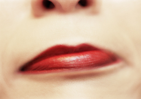 puzzlement: Close up of womans mouth frowning, blurred