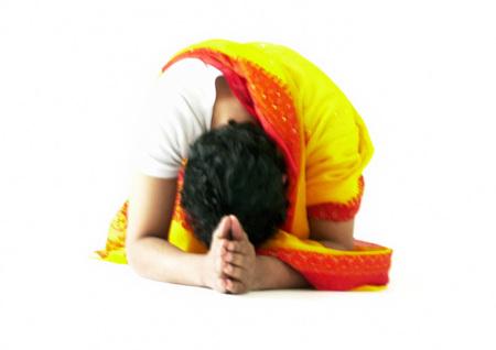 Hindu man bending over and praying