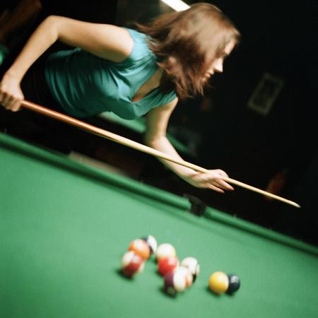 deftness: Young woman shooting pool