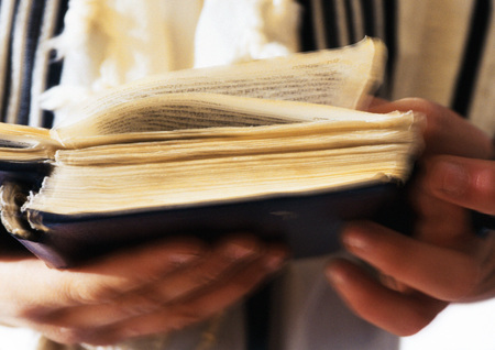 rite: Jewish mans hands holding Torah, close-up